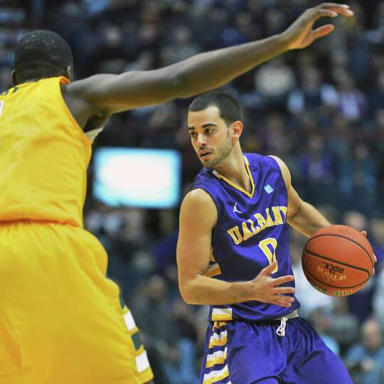 UAlbany's #0 Jacob Iati, at right, looks for a way around Siena's #1 O.D.Anosike during Saturdays ga