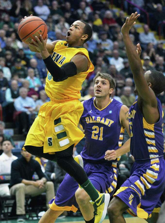 Siena's #5 Evan Hymes, left, goes to the hoop  during Saturdays game against UAlbany at the Times Union Center in Albany Dec. 1, 2012.  (John Carl D'Annibale / Times Union) Photo: John Carl D'Annibale / 00020104A