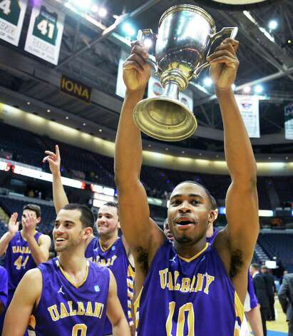 UAlbany's #10 Mike Black crries the Albany Cup trophy after defeating Siena College Saturday at the Times Union Center in Albany Dec. 1, 2012.  (John Carl D'Annibale / Times Union) Photo: John Carl D'Annibale / 00020104A