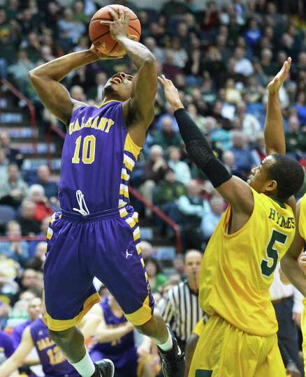 UAlbany's #10  Mike Black goes to the net as Siena's #5 Evan Hyams defends during Saturdays game at