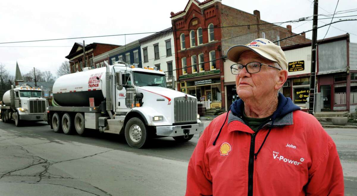 Mayor John Wilson stands at the main intersection as water trucks roll through town on the way to a hydro-fracking site on Tuesday, Nov. 13, 2012, in Montrose, Penn. (Cindy Schultz / Times Union)