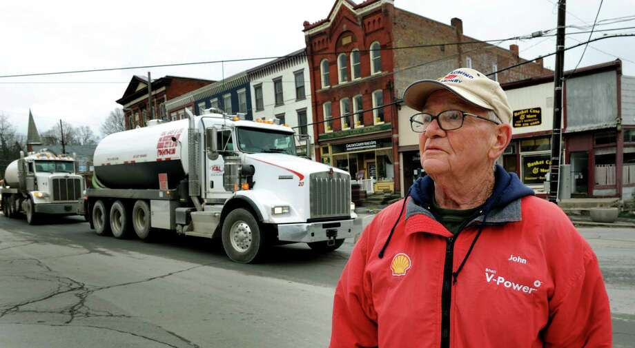 Mayor John Wilson stands at the main intersection as water trucks roll through town on the way to a hydro-fracking site on Tuesday, Nov. 13, 2012, in Montrose, Penn. (Cindy Schultz / Times Union) Photo: Cindy Schultz