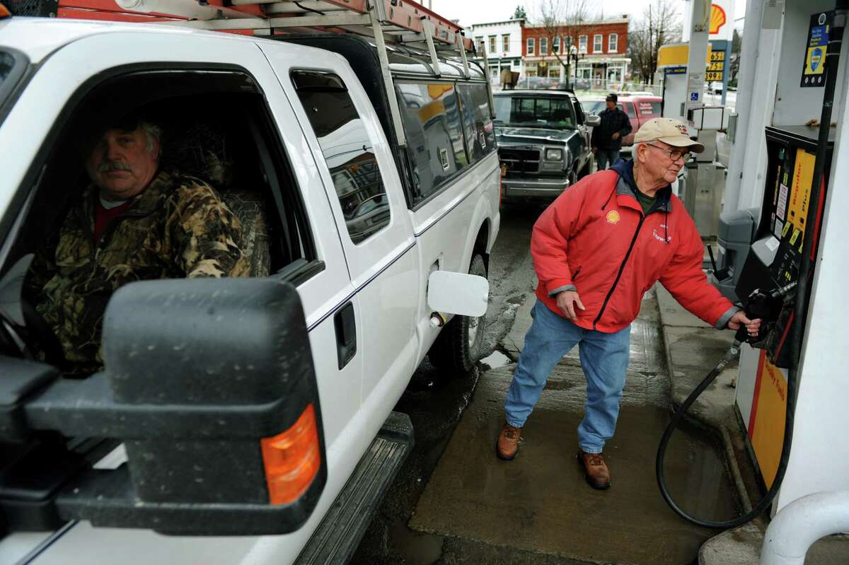 John Wilson, part-time mayor, finishes pumping gas for a customer at the Shell gas stationon Tuesday, Nov. 13, 2012, in Montrose, Penn. (Cindy Schultz / Times Union)