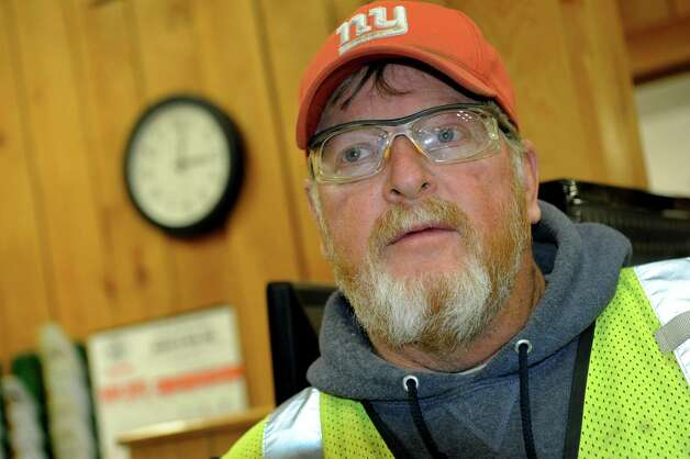 Ralph Felter of Sidney, N.Y., who leads a restoration crew for Rockford Corp., picks up grass seeding on Tuesday, Nov. 13, 2012, at Andre and Son Inc. in Montrose, Penn. Rockford Corp. is doing natural gas pipeline construction and maintenance and directional drilling. (Cindy Schultz / Times Union) Photo: Cindy Schultz