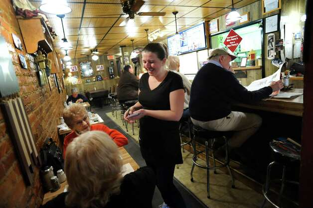 Wendy Fisher, a newly hired waitress, center, takes a breakfast order on Wednesday, Nov. 14, 2012, at Miss Penny's Diner in Montrose, Penn. (Cindy Schultz / Times Union) Photo: Cindy Schultz