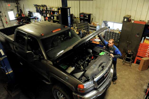 Daniel Zaleski, owner of D.A.N.Z. Automotive Service and Repair, lifts the hood of a pickup truck on Wednesday, Nov. 14, 2012, in Montrose, Penn. (Cindy Schultz / Times Union) Photo: Cindy Schultz