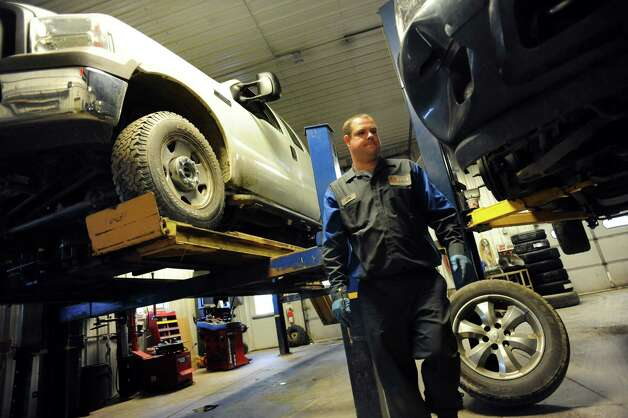 Daniel Zaleski, owner of D.A.N.Z. Automotive Service and Repair, has plenty of business on Wednesday, Nov. 14, 2012, in Montrose, Penn. (Cindy Schultz / Times Union) Photo: Cindy Schultz