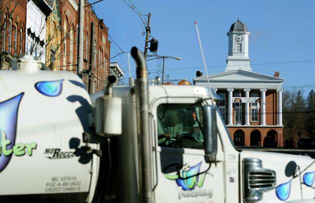 A water truck rolls through the main intersection on Wednesday, Nov. 14, 2012, in Montrose, Penn. (Cindy Schultz / Times Union) Photo: Cindy Schultz