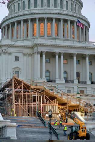 Construction continues on the viewing stands for President Barack Obama's January's Inauguration Day ceremonies, early Wednesday, Nov. 28, 2012, on Capitol Hill in Washington.  (AP Photo/J. Scott Applewhite) Photo: J. Scott Applewhite, Associated Press / AP