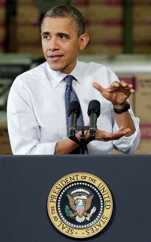 President Barack Obama gestures as he speaks at The Rodon Group manufacturing facility, Friday, Nov. 30, 2012, in Hatfield, Pa. Obama spoke at the toy company about how middle class Americans would see their taxes go up if Congress fails to act to extend the middle class tax cuts. (AP Photo/Matt Slocum) Photo: Matt Slocum, Associated Press / AP