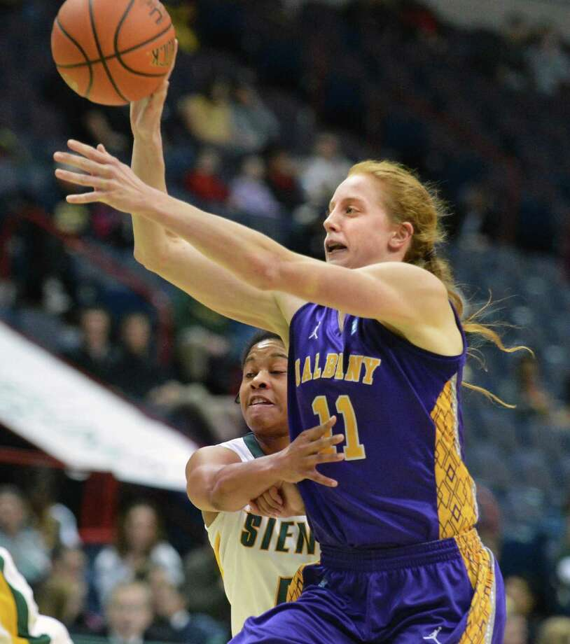 UAlbany's #11 Julie Forster, at right, and Siena's #5 Ciara Stewart during Saturday's game at the Times Union Center in Albany Dec. 1, 2012.  (John Carl D'Annibale / Times Union) Photo: John Carl D'Annibale / 00020278A