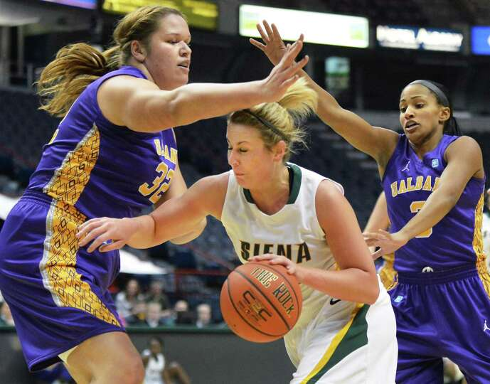 Siena's # 22 Lily Genci, center, is double teamed by UAlbany's #32 Megan Craig, left, and # 3 Margar