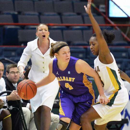 Siena'head coach Ali Jaques, left, calls out to Tehresa Coles, at right, as she guards UAlbany's #4