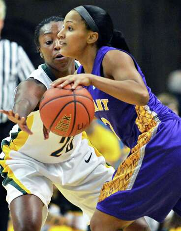 Siena's #25 Tehresa Coles, left, and UAlbany's #3  Margarita Rosario during Saturday's game at the Times Union Center in Albany Dec. 1, 2012.  (John Carl D'Annibale / Times Union) Photo: John Carl D'Annibale / 00020278A