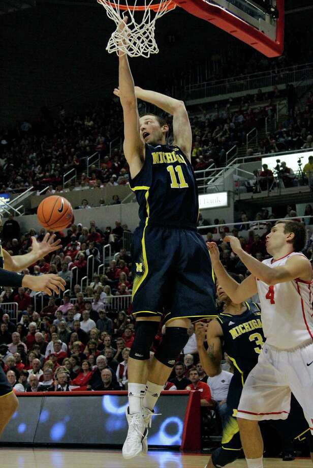 Michigan guard Nik Stauskas (11) fights for a rebound against Bradley's Jake Eastman (4) during the first half of an NCAA college basketball game on Saturday, Dec. 1, 2012, in Peoria Ill. (AP Photo/Seth Perlman) Photo: Seth Perlman / AP