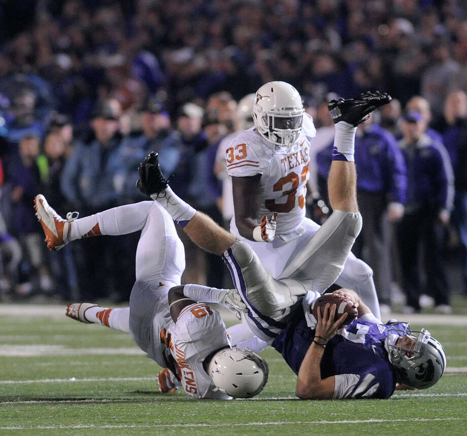 Kansas State University quarterback Colin Klein gets sacked by the University of Texas' Peter Jinkens, bottom, and Steve Edmond. Photo: Evan Paul Semón, For The Houston Chronicle / Evan Semón