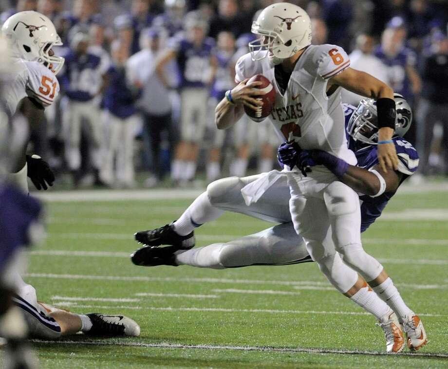 Kansas State University's Meshak Williams pulls down The University of Texas' quarterback Case McCoy. Photo: Evan Paul Semón, For The Houston Chronicle / Evan Semón