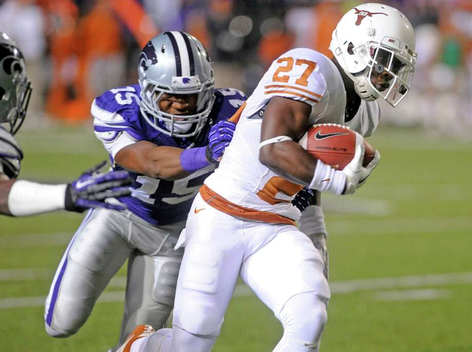 Kansas State University defender Randall Evans, right, chases down The University of Texas' Daje Johnson. Photo: Evan Paul Semón, For The Houston Chronicle / Evan Semón