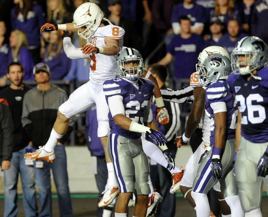 Kansas State University players look on as the University of Texas celebrates a second quarter touchdown. Photo: Evan Paul Semón, For The Houston Chronicle / Evan Semón