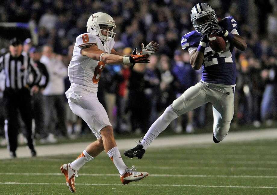 Kansas State University defensive back Nigel Malone, right, intercepts a ball thrown to University of Texas wide receiver Jaxon Shipley. Photo: Evan Paul Semón, For The Houston Chronicle / Evan Semón