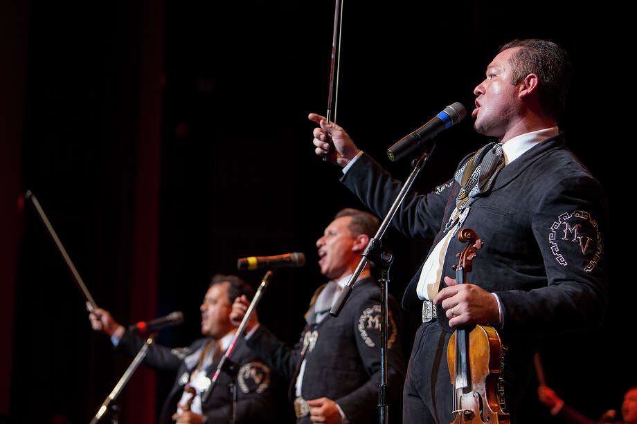 "Jose ""Pepe"" Martinez, Jr., right, of Mariachi Vargas plays with the band at Lila Cockrell Theatre on Saturday, Dec. 1, 2012. Photo: Michael Miller, For The Express-News / © San Antonio Express-News"