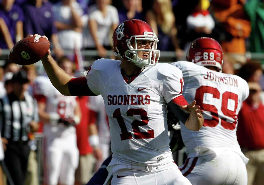 Oklahoma quarterback Landry Jones (12) passes against TCU during the first half of an NCAA college football game, Saturday, Dec. 1, 2012, in Fort Worth, Texas. (AP Photo/Tony Gutierrez) Photo: Tony Gutierrez