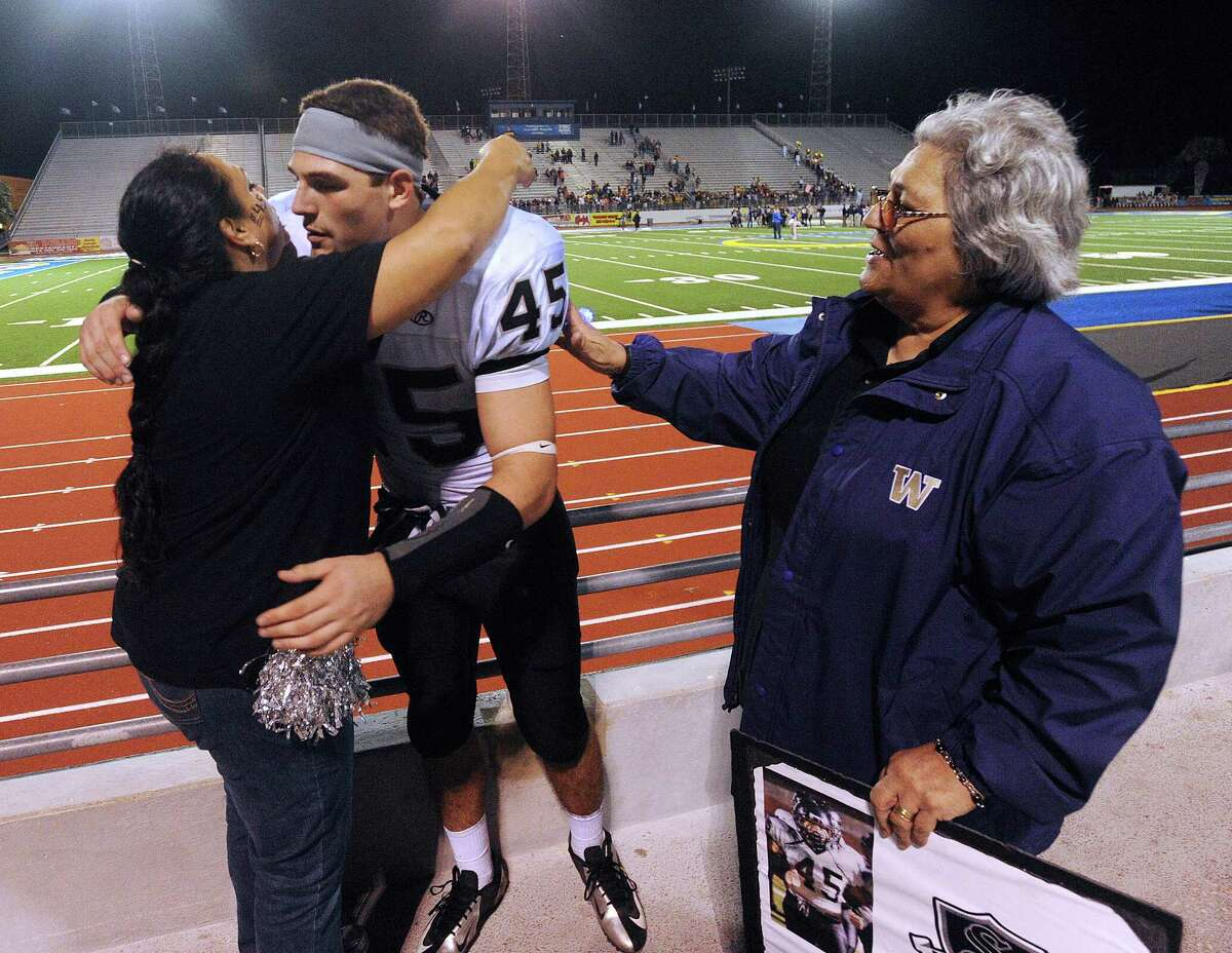 Linebacker Garth Tubbs of Steele High School is greeted by his mother, Jessica Razo, left, and grandmother, Tina Razo, after Steele defeated Edinburg North, 38-0 to advance in Class 5A Division II football playoffs in Kingsville on Saturday, Dec. 1, 2012.