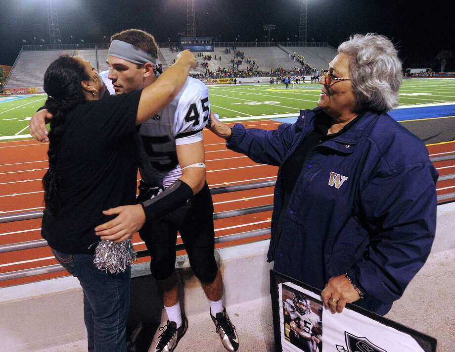 Linebacker Garth Tubbs of Steele High School is greeted by his mother, Jessica Razo, left, and grandmother, Tina Razo, after Steele defeated Edinburg North, 38-0 to advance in Class 5A Division II football playoffs in Kingsville on Saturday, Dec. 1, 2012. Photo: Billy Calzada, Express-News / SAN ANTONIO EXPRESS-NEWS