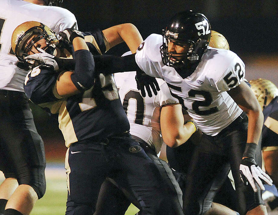 Aaron Rivera, left, of Edinburg North, and Steele defensive end Matthew Simmons (52) shove each other during Class 5A Division II football playoffs action in Kingsville on Saturday, Dec. 1, 2012. Photo: Billy Calzada, Express-News / SAN ANTONIO EXPRESS-NEWS