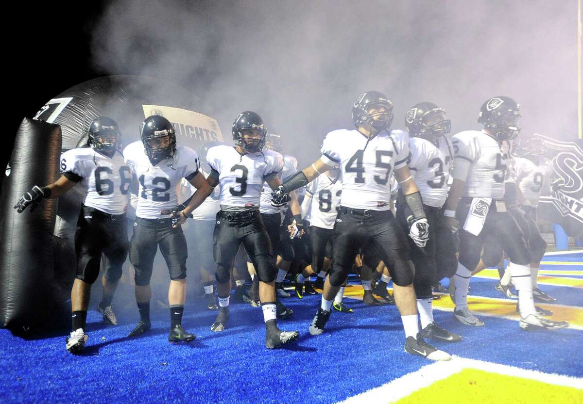 The Steele Knights take the field for their Class 5A Division II playoff game against Edinburg in Kingsville on Saturday, Dec. 1, 2012.