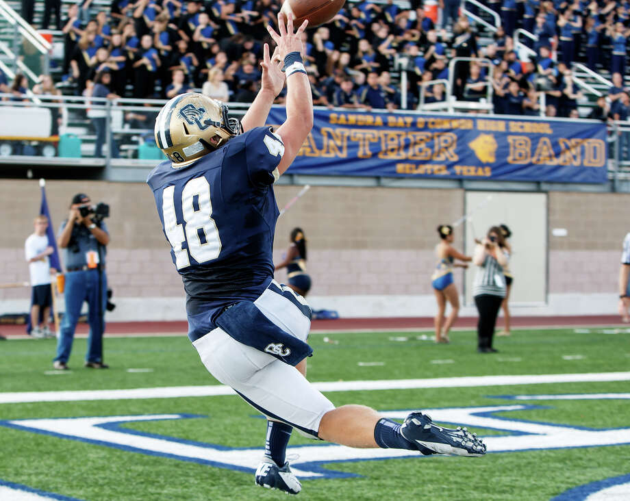 O'Connor's Clay Lansdale goes up for a ball at the back of the end zone during the second quarter of their Class 5A Division II third round game with Laredo Alexander at Farris Stadium on Dec. 1, 2012.  Lansdale made the catch but was out of bounds.  O'Connor won the game 44-24.  MARVIN PFEIFFER/ mpfeiffer@express-news.net Photo: MARVIN PFEIFFER, Express-News / Express-News 2012