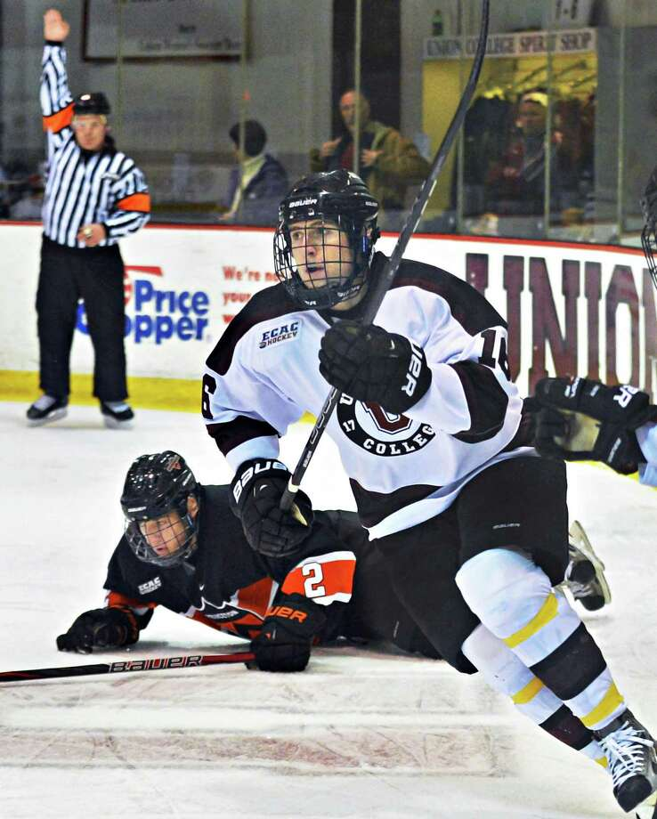 Union's #16 Kevin Sullivan crashes through Princeton's #2 Alec Rush during Saturday's game with  at the Messa Rink in Schenectady Dec. 1, 2012.  (John Carl D'Annibale / Times Union) Photo: John Carl D'Annibale / 00020275A