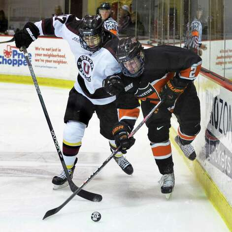Union's #17 Daniel Ciampini, left, and Princeton's #2 Alec Rush vie for the puck during Saturday's game with  at the Messa Rink in Schenectady Dec. 1, 2012.  (John Carl D'Annibale / Times Union) Photo: John Carl D'Annibale / 00020275A