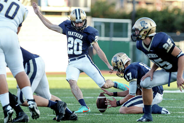 O'Connor's Troy Thienpont holds as Ryan Hoskins kicks a 41-yard field goal during the fourth quarter of their Class 5A Division II third round game with Laredo Alexander at Farris Stadium on Dec. 1, 2012.  O'Connor won the game 44-24.  MARVIN PFEIFFER/ mpfeiffer@express-news.net Photo: MARVIN PFEIFFER, Express-News / Express-News 2012