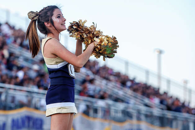 O'Connor cheerleader Breanna Canales cheers for the Panthers during their Class 5A Division II third round game with Laredo Alexander at Farris Stadium on Dec. 1, 2012.  O'Connor won the game 44-24.  MARVIN PFEIFFER/ mpfeiffer@express-news.net Photo: MARVIN PFEIFFER, Express-News / Express-News 2012