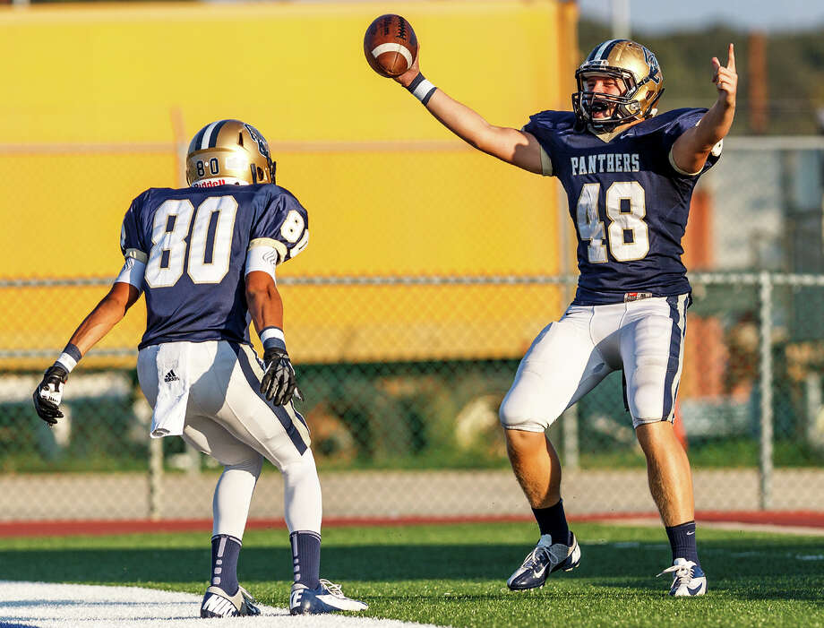 O'Connor's Clay Lansdale (right) celebrates his 24-yard touchdown reception in the end zone with Alonso Roscoe during the third quarter of their Class 5A Division II third round game at Farris Stadium on Dec. 1, 2012.  O'Connor won the game 44-24.  MARVIN PFEIFFER/ mpfeiffer@express-news.net Photo: MARVIN PFEIFFER, Express-News / Express-News 2012