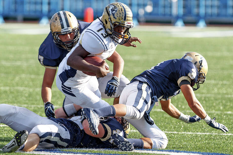 "O'Copnnor's Kody Fields (below), Juan Bradford and Eddie Vasquez bring down Laredo Alexander's Xavione Skaggs during the second quarter of their Class 5A Division II third round game at Farris Stadium on Dec. 1, 2012.  O""Connor won the game 44-24.  MARVIN PFEIFFER/ mpfeiffer@express-news.net Photo: MARVIN PFEIFFER, Express-News / Express-News 2012"