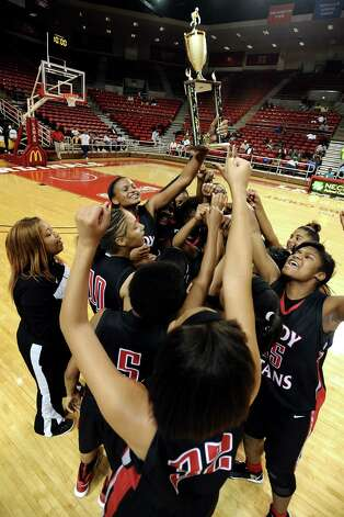 The Port Arthur-Memorial Lady Titans high school basketball game against the Ozen Lady Panthers on Saturday December 1, 2012, in the championship basketball game of the annual BISD YMBL South Texas Shootout at the Lamar University Montagne Center. Port Arthur-Memorial won over Ozen 53-52.  Photo taken: Randy Edwards/The Enterprise Photo: Randy Edwards