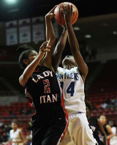 Lady Panther Bealoved Brown, #14, is fouled by Lady Titan  Joyce Kennerson, #2, in an attempt to block her shot during the Port Arthur-Memorial Lady Titans high school basketball game against the Ozen Lady Panthers on Saturday December 1, 2012, in the championship basketball game of the annual BISD YMBL South Texas Shootout at the Lamar University Montagne Center. Port Arthur-Memorial won over Ozen 53-52.  Photo taken: Randy Edwards/The Enterprise Photo: Randy Edwards