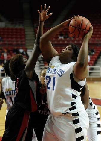 Lady Panther Nekia Jones, #21, charges to the goal to gain 2 more points during the Port Arthur-Memorial Lady Titans high school basketball game against the Ozen Lady Panthers on Saturday December 1, 2012, in the championship basketball game of the annual BISD YMBL South Texas Shootout at the Lamar University Montagne Center. Port Arthur-Memorial won over Ozen 53-52.  Photo taken: Randy Edwards/The Enterprise Photo: Randy Edwards