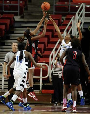 Lady Titan Dorcieve Davis, #22, puts the ball up for 2 points during the Port Arthur-Memorial Lady Titans high school basketball game against the Ozen Lady Panthers on Saturday December 1, 2012, in the championship basketball game of the annual BISD YMBL South Texas Shootout at the Lamar University Montagne Center. Port Arthur-Memorial won over Ozen 53-52.  Photo taken: Randy Edwards/The Enterprise Photo: Randy Edwards