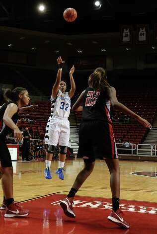 Lady Panther Alexandra Moten, #32, shoots and makes 2 points during the Port Arthur-Memorial Lady Titans high school basketball game against the Ozen Lady Panthers on Saturday December 1, 2012, in the championship basketball game of the annual BISD YMBL South Texas Shootout at the Lamar University Montagne Center. Port Arthur-Memorial won over Ozen 53-52.  Photo taken: Randy Edwards/The Enterprise Photo: Randy Edwards