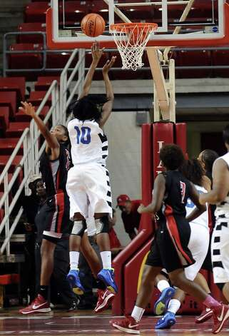 Lady Panther SanQueisha Rawls, #10, puts the ball up for 2 points during the Port Arthur-Memorial Lady Titans high school basketball game against the Ozen Lady Panthers on Saturday December 1, 2012, in the championship basketball game of the annual BISD YMBL South Texas Shootout at the Lamar University Montagne Center. Port Arthur-Memorial won over Ozen 53-52.  Photo taken: Randy Edwards/The Enterprise Photo: Randy Edwards