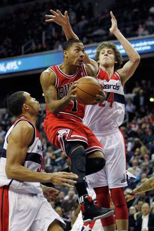 WASHINGTON, DC - JANUARY 30: Derrick Rose #1 of the Chicago Bulls puts up a shot in front of JaVale McGee #34 and Jan Vesely #24 of the Washington Wizards during the first half at Verizon Center on January 30, 2012 in Washington, DC. (Photo by Rob Carr/Getty Images) Photo: Rob Carr / 2012 Getty Images
