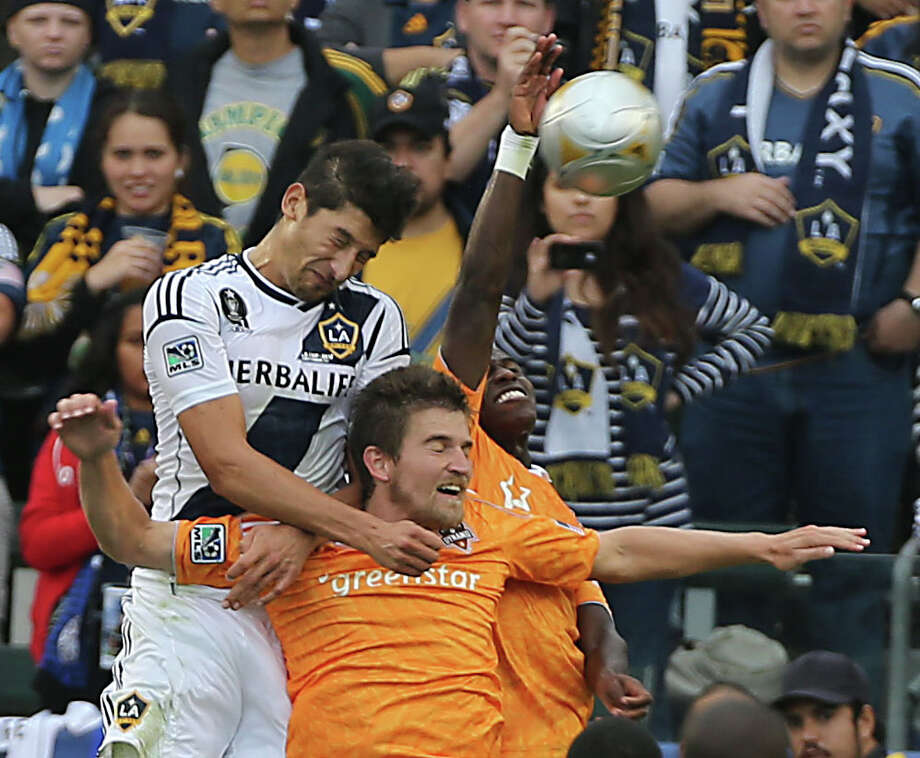 Galaxy defender Omar Gonzalez left, used his 6-5 frame to beat the Dynamo to most balls in the air during Saturday's match. Photo: James Nielsen, Staff / © Houston Chronicle 2012