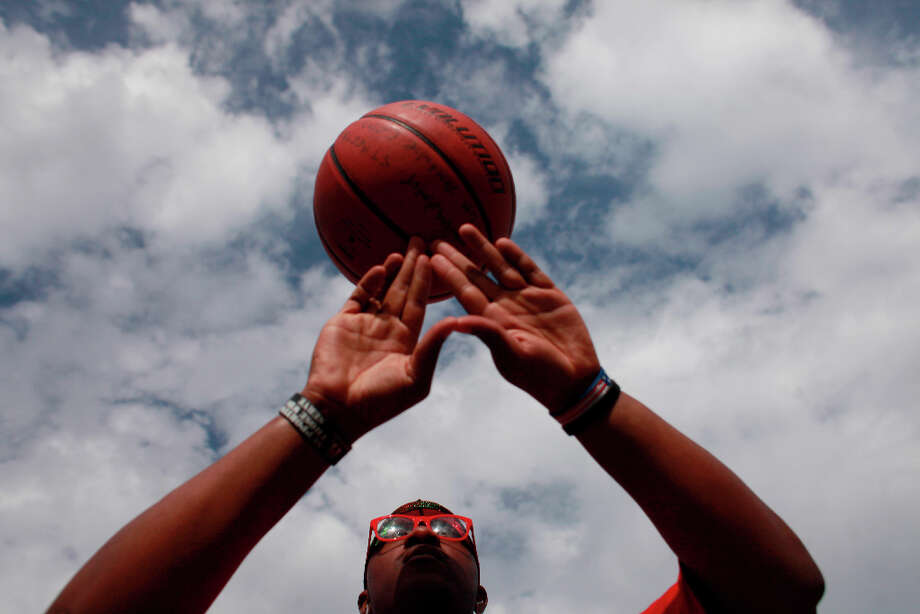Streetballer Craig McArthur spins a basketball on his fingertips near his home in Diamond Heights. Photo: Mike Kepka, The Chronicle / ONLINE_YES