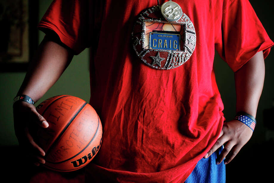 Streetballer Craig McArthur shows off his Intimidator persona inside his home in Diamond Heights. Photo: Mike Kepka, The Chronicle / ONLINE_YES