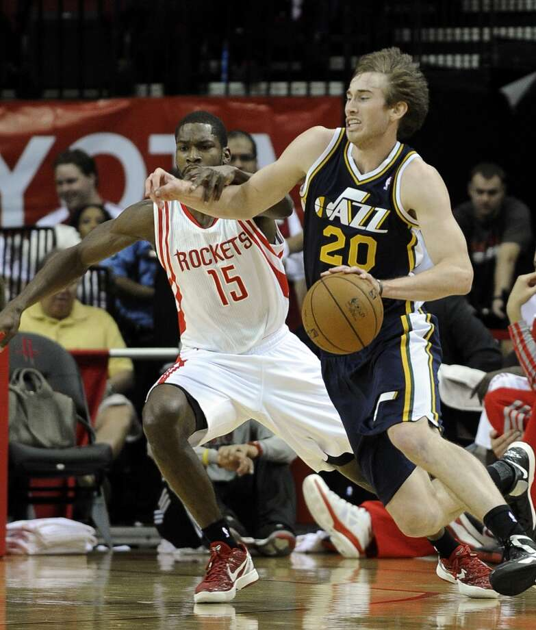 Jazz guard Gordon Hayward tries to get past Toney Douglas of the Rockets. (Pat Sullivan / Associated Press)