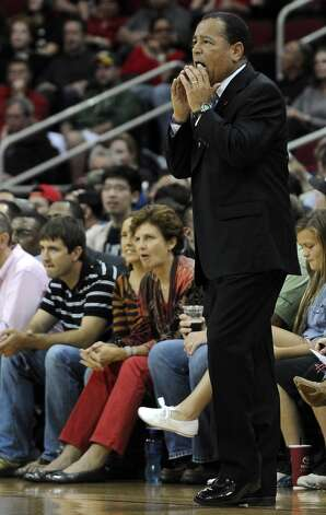 Rockets acting coach Kelvin Sampson directs his players. (Pat Sullivan / Associated Press)