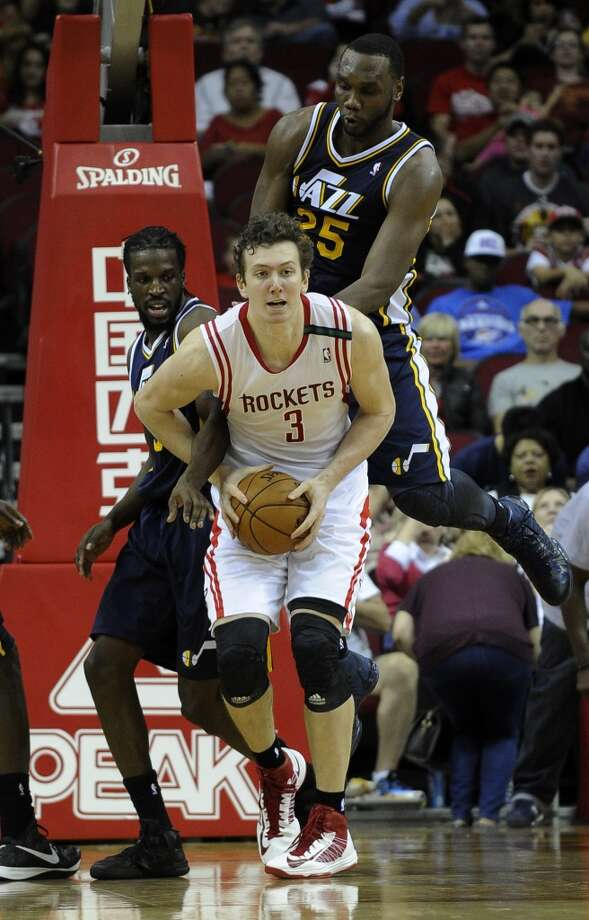 Rockets center Omer Asik looks to pass the ball. (Pat Sullivan / Associated Press)